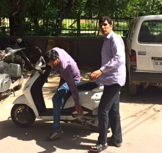 Saurabh Bhardwaj (right) about to board the scooter