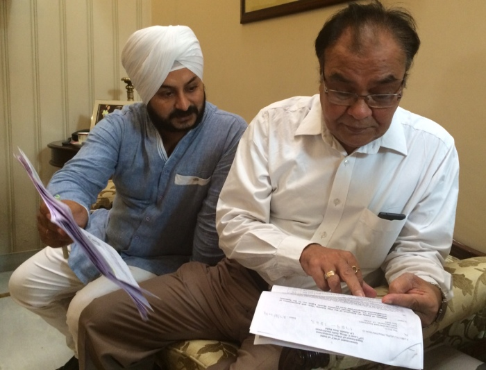 Shankar Garden's RWA President inspecting Government paperwork.