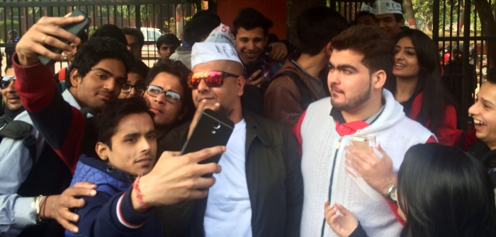 """Vishal easily featured in over 1000 selfies that afternoon, making an impact on thousands of young voters as he proudly sported his """"mai hoon aam aadmi"""" cap."""